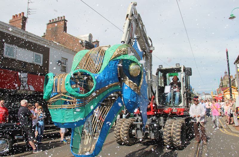 Sea monster head mounted on 8 ton excavator boom for Spare Parts Parade, Tram Sunday 2016