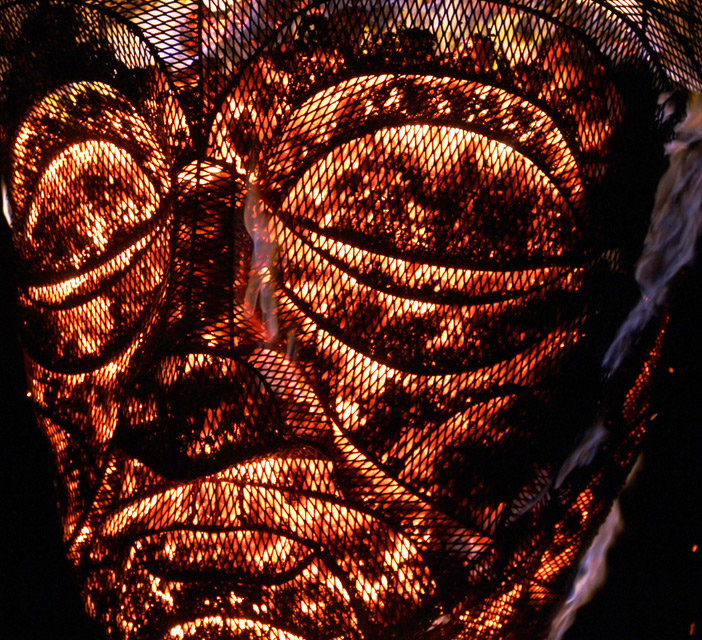 Close up of a Hot Head - charcoal fire sculpture made with pa-Boom